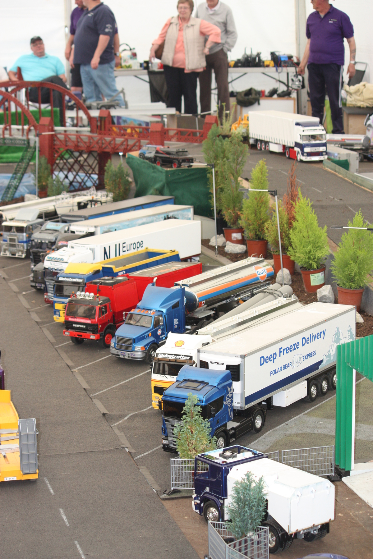 Lifelike trucks lined up ready for a display